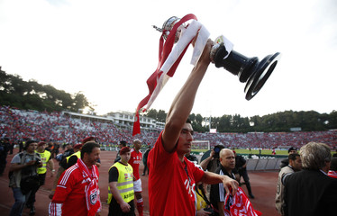 Benfica's Oscar Cardozo holds the trophy after winning their Portuguese Cup final soccer match against Rio Ave at the National stadium in Lisbon