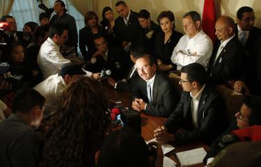 Legislator Oviedo speaks to the media at Costa Rica's congress in San Jose