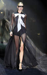 A model presents a creation by Gucci during the Autumn/Winter 2011 women collection show at Milan's Fashion Week