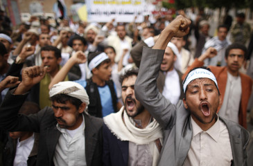 Protesters shout slogans during a demonstration against potential strikes on the Syrian government, in Sanaa
