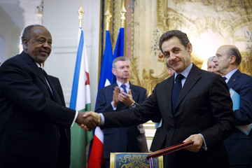 France's President Sarkozy shakes hands with Djibouti's President Ismail Omar Guelleh during a meeting at the Elysee Palace in Paris