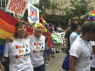 Same-sex marriage supporters demonstrate outside courthouse in Miami