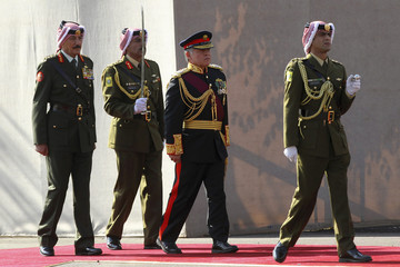 Jordan's King Abdullah reviews the honour guard before the 17th Ordinary Session of Parliament in Amman