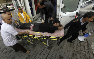 A member of the free Syrian Army lies on a stretcher in the Turkish border town of Ceylanpinar
