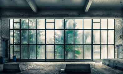 Foto op Plexiglas Oude verlaten gebouwen The view from an old, abandoned factory on the inside with nice window light