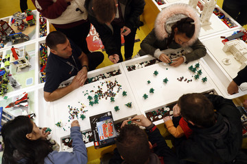 People building Lego christmas trees in the world's biggest Lego store in Leicester Square in London
