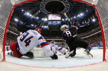 Russia's goaltender Bobrovski makes a save past Eichel of the U.S. during their Ice Hockey World Championship semifinal game at the O2 arena in Prague