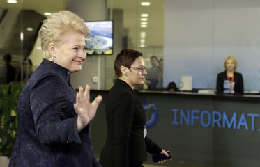 Lithuanian President Grybauskaite waves as she arrives to welcome guests at the EU Eastern Partnership summit in Vilnius