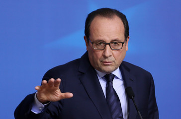 France's President Hollande addresses a news conference after an EU leaders summit in Brussels