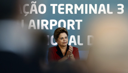 Brazilian President Dilma Rousseff gestures as she attends the inauguration of Terminal 3 at Guarulhos International airport in Sao Paulo