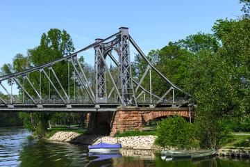 Old Iron Bridge across the river, on a stone base
