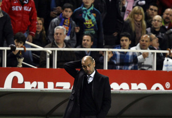 Barcelona's coach Guardiola reacts during their Spanish first division soccer match against Sevilla in Seville