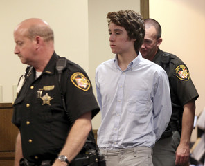 Chardon High School suspected gunman TJ Lane is escorted into court for his court appearance, by Sheriffs deputies in Chardon