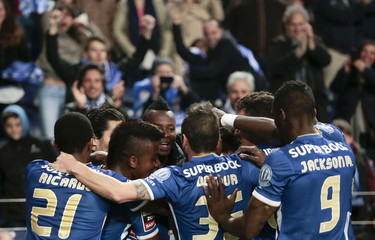 Porto's players celebrate their goal against Belenenses during their Portuguese Premier League soccer match at Dragao stadium in Porto