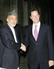 Britain's Deputy PM Clegg shakes hands with Afghan President Karzai at the Presidential Palace in Kabul