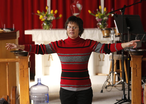 Hitchcock delivers her sermon to the congregation during a Sunday morning church service at the Open Door Community Fellowship Church in Louisville
