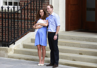 Britain's Prince William and his wife Catherine, Duchess of Cambridge appear with their baby son outside the Lindo Wing of St Mary's Hospital, in central London