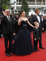 Director Audiard arrives on the red carpet with cast members Schoenaerts Verdure and Cotillard for the screening of the film De rouille et d'os at the 65th Cannes Film Festival