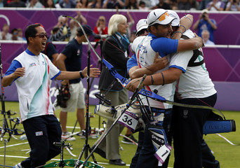 Italy's team celebrate their win over the U.S. during the men's archery team gold medal match at the Lords Cricket Ground during the London 2012 Olympics Games