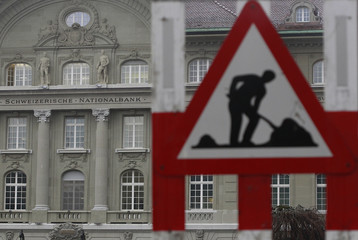 A safety construction sign stands outside the Swiss National Bank building in Bern
