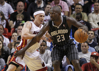Miami Heat point guard Mike Bibby defends against Orlando Magic shooting guard Jason Richardson in Miami