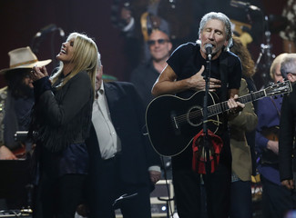 """Musicians Waters and Potter perform with other guests during the """"Love for Levon"""" charity event at the Izod Center in East Rutherford"""