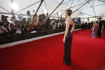 Actress Jennifer Lawrence poses as she arrives at the 20th annual Screen Actors Guild Awards in Los Angeles