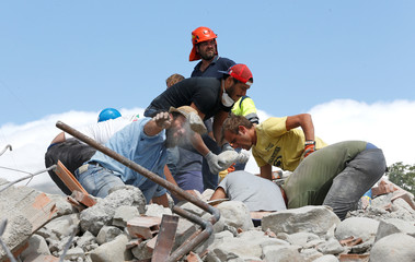 Rescuers work following an earthquake in Amatrice