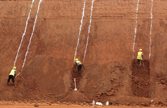 Construction laborers work at a landscaping section of the Mombasa-Nairobi standard gauge railway near Emali