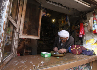A man waits for customers in his shop selling sundries in the Bab Al-Sebah market in Sanaa