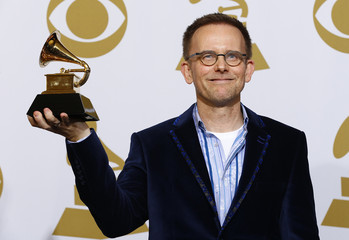 "Conductor Craig Hella Johnson poses with his award for best choral performance for his work on ""The Sacred Spirit Of Russia"" backstage at the 57th annual Grammy Awards in Los Angeles"
