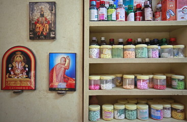 File photo of pictures of Hindu gods hanging beside a medicine rack inside a clinic in Pune
