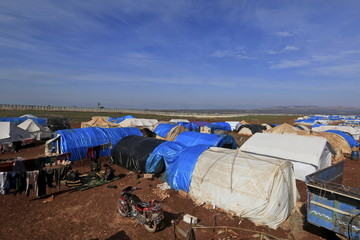 A general view shows tents housing internally displaced people in Atma camp, near the Syrian-Turkish border in Idlib Governorate