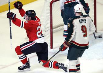 Chicago Blackhawks' Brandon Saad celebrates his goal as Minnesota Wild's Mikko Koivu looks on during their NHL hockey game in Chicago