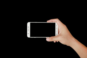 One hand holding mobile smartphone with black screen. Mobile photography concept. Isolated on black.