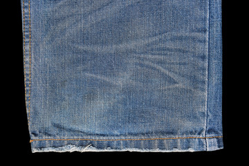 Blue jeans texture isolated on black background.