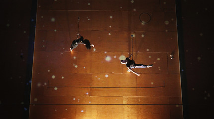 """Performers from the group Legs On The Wall dance while suspended from cables in front of a wall projection during a media call for their production of """"The Voyage"""" in Sydney"""