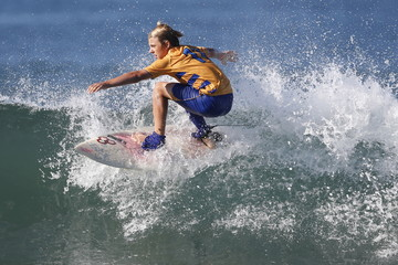 A competitor surfs dressed as a soccer player during the ZJ Boarding House Haunted Heats Halloween Surf Contest in Santa Monica
