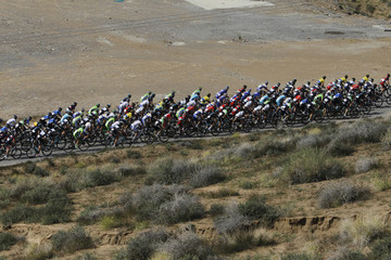 The peloton rides up a climb during the 140km (87 miles) stage three of the Tour Of Oman cycling race