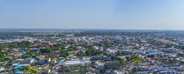 Cityscape view from top of the hill or mountain with white cloud and blue sky, view from top of Khao Sakae Krang mountain, Uthai Thani province, Thailand