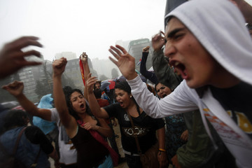 """Members of the """"Yosoy132"""" movement shout slogans and gesture during a demonstration demanding transparency in election results, in Mexico City"""