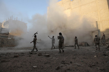 Free Syrian Army fighters launch locally made rockets in Deir al-Zor