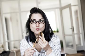 Woman Eating Banana for Breakfast
