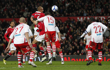 Manchester United's Wes Brown scores against Crawley Town during their English FA Cup soccer match at Old Trafford in Manchester