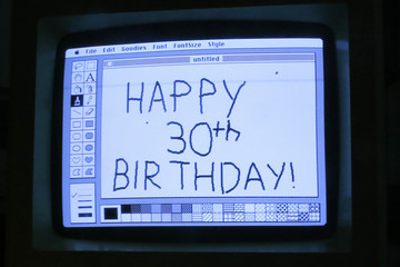 "Curator Adam Rosen writes ""Happy 30th Birthday"" using version 1 of MacPaint on an original 128K Macintosh computer at the Vintage Mac Museum in Malden"