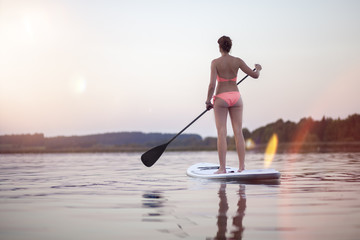 Germany, Bavaria, Chiemsee, woman on SUP Board