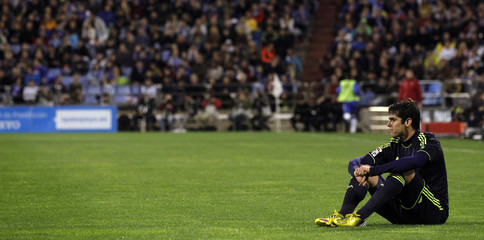 Real Madrid's Kaka sits on the pitch during their Spanish First division soccer league match against Zaragoza at La Romareda stadium in Zaragoza