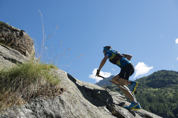 Italy, Alagna, trail runner on the move near Monte Rosa mountain massif