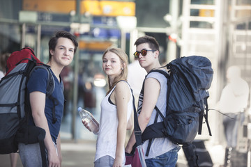 Young people traveling with backpacks, exploring Berlin