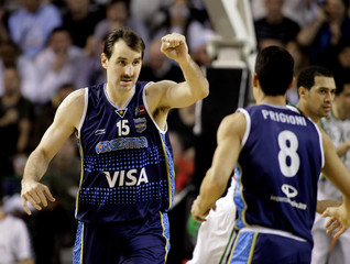 Argentina's Kammerichs celebrates a point with team mate Prigioni during final round FIBA Americas Championship basketball game against Brazil in Mar del Plata